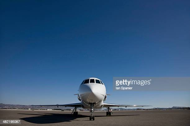 Stationary private jet on airfield tarmac