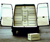Stationary van loaded with boxes, doors open, rear view
