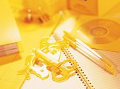 Stationeries on table in yellow