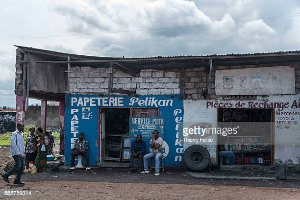 A stationery and a shop selling car spare parts lie in a Goma district rebuilt on a layer of lava resulting from the eruption in 2002 of the nearby...