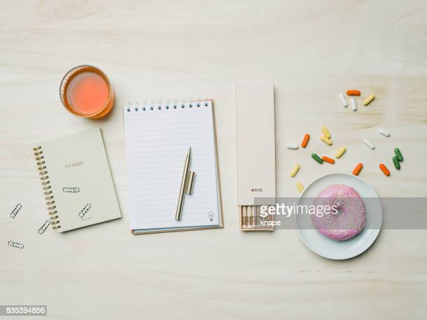 Stationery from above with notebook pencils