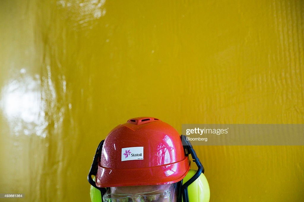 A Statoil ASA logo sits on a worker's safety helmet the Troll A natural gas platform operated by Statoil in the North Sea Norway on Wednesday Oct 21...