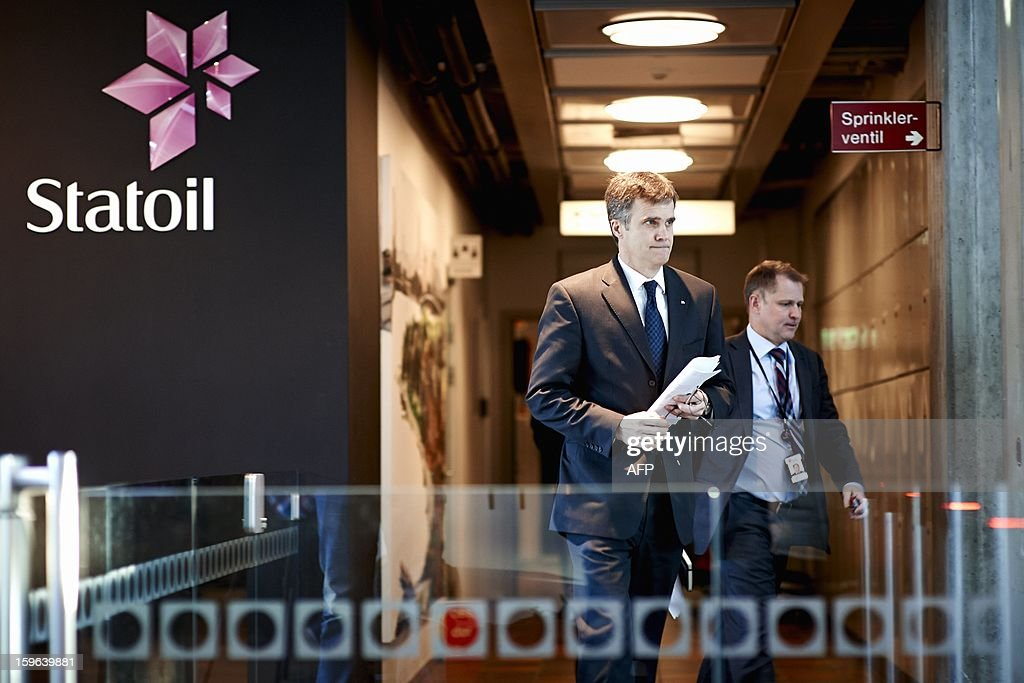 Statoil CEO Helge Lund (L), and Statoil's director of foreign operations, Lars Christian Bacher, leave a meeting at Statoil headquarters in Stavanger on January 17, 2013. The Algerian military launched on Thursday an air and ground assault on a desert gas complex where Islamists were still holding an unknown number of hostages, one of the kidnappers told the ANI news agency. AFP PHOTO/ Kent Skibstad / SCANPIX NORWAY/NORWAY OUT