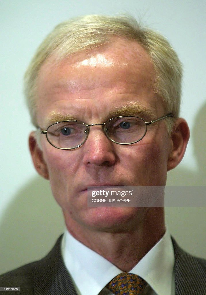 Statoil chief executive officer Olav Fjell looks downcast at a press conference 23 September 2003 in Oslo Fjell resigned overnight as CEO of Statoil...