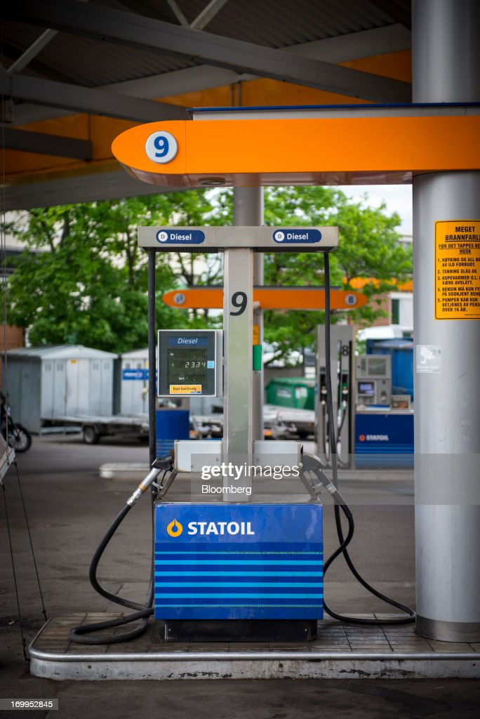 A Statoil company logo sits displayed on a diesel fuel pump on the forecourt of a gas station operated by Statoil ASA in Oslo Norway on Tuesday June...