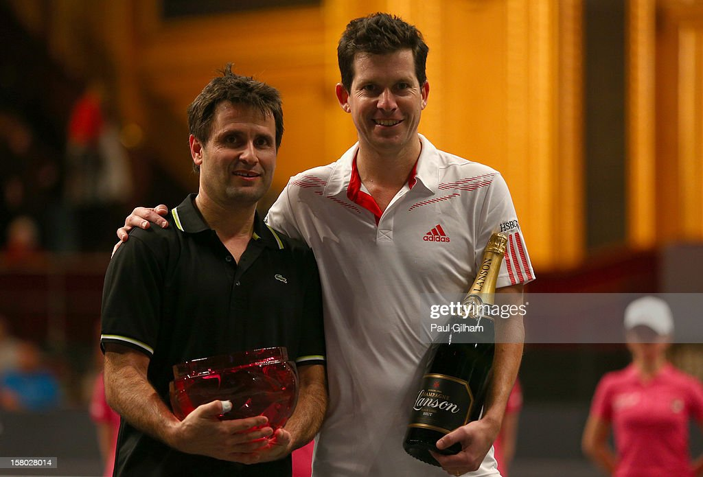 Statoil Masters Tennis ATP Champions Tour Final winner <a gi-track='captionPersonalityLinkClicked' href=/galleries/search?phrase=Fabrice+Santoro&family=editorial&specificpeople=206131 ng-click='$event.stopPropagation()'>Fabrice Santoro</a> of France poses with losing finalist <a gi-track='captionPersonalityLinkClicked' href=/galleries/search?phrase=Tim+Henman&family=editorial&specificpeople=167277 ng-click='$event.stopPropagation()'>Tim Henman</a> of Great Britain after the ATP Champions Tour Final between <a gi-track='captionPersonalityLinkClicked' href=/galleries/search?phrase=Tim+Henman&family=editorial&specificpeople=167277 ng-click='$event.stopPropagation()'>Tim Henman</a> of Great Britain and <a gi-track='captionPersonalityLinkClicked' href=/galleries/search?phrase=Fabrice+Santoro&family=editorial&specificpeople=206131 ng-click='$event.stopPropagation()'>Fabrice Santoro</a> of France during the Statoil Masters Tennis at Royal Albert Hall on December 9, 2012 in London, England.