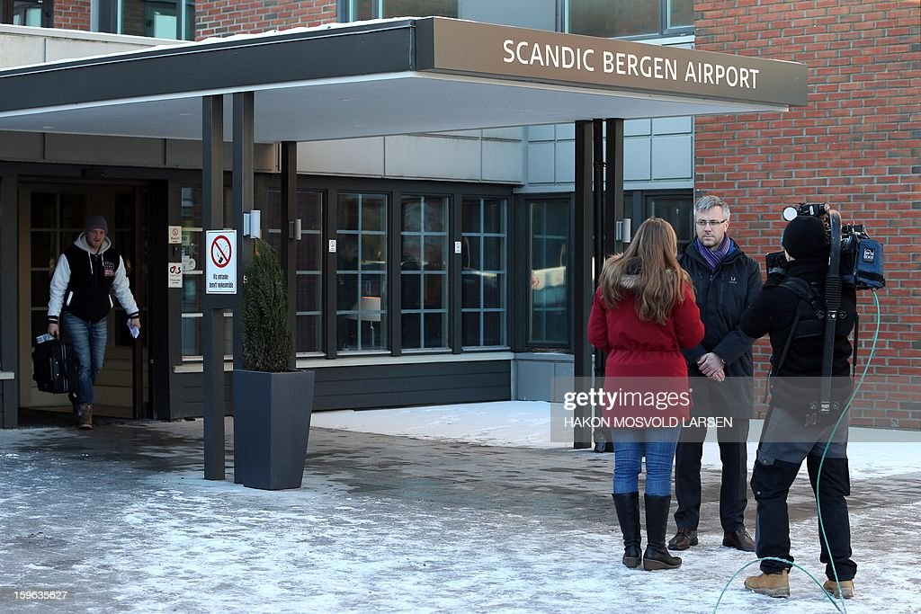 Statoil spokesman Ole Anders Skauby (C) talks to TV reporters outside Scandic Bergen Airport hotel on January 17, 2013 where a drop-in center is established for relatives of hostages involved in the situation in Algeria. Fifteen foreigners and 30 Algerians being held hostage by Islamist extremists at a gas field in Algeria managed to escape from their kidnappers on Thursday, local media reported, citing officials. AFP PHOTO / SCANPIX NORWAY/Hakon Mosvold Larsen /NORWAY OUT
