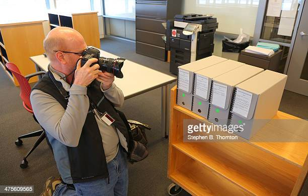 Staton Breidenthal a photojournalist with the Arkansas DemocratGazette photographs 4 boxes containing around 3400 documents inside a research room at...