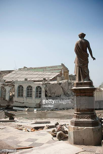 Statue and destroyed city