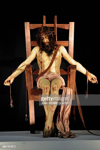 A statue called 'Pieta' representing Jesus Christ sitting on an electric chair created by British sculptor Paul Fryer is displayed at the Cathedral...