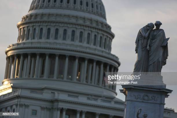 A statue dedicated to the officers seamen and Marines of the US Navy is seen near the dome of Capitol Hill in Washington DC on July 25 2017
