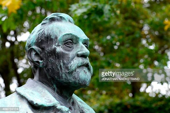 A statue featuring Swedish inventor of dynamite Alfred Nobel is seen outside the Karolinska Institutet in Stockholm where the Nobel Committee is to...