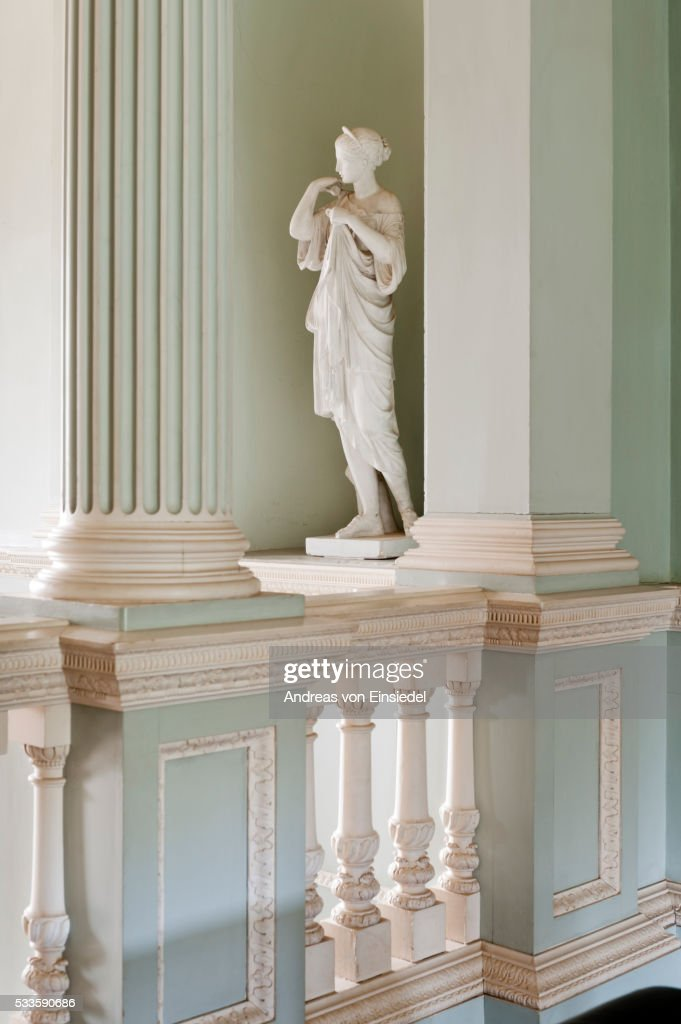 Statue in a niche in the Staircase Hall, The Vyne, Hampshire.