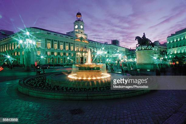 Statue in front of a building at night, Puerta del Sol Square, Madrid, Spain