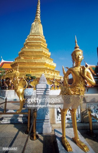Statue In Front Of The Temple Of The Emerald Buddha Wat ...