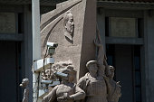A statue in honour of Chairman Mao is obscured behind a row of closed circuit television surveillance cameras in Tiananmen Square Beijing China...