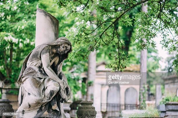 Statue in Pere Lachaise cementary in Paris