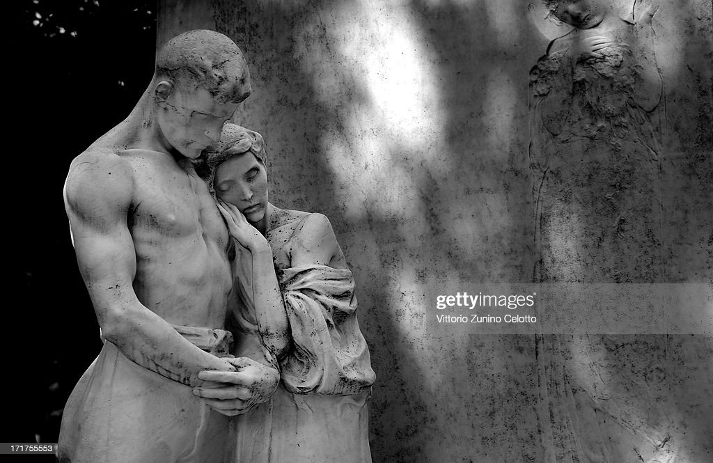 A statue is diplayed at Milan's Monumental Cemetery on April 24, 2013 in Milan, Italy. Milans Monumental Cemetery or Cimitero Monumentale is one of the 2 largest cemeteries in Milan and is noted for the artistic nature of its tombs. It was designed by Carlo Maciachini in 1866 with the intention of it amalgamating many smaller cemeteries around the city into one main building, and occupies 250,000 square meters.