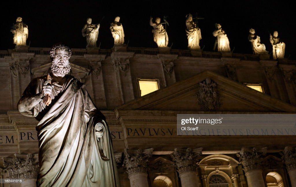 A statue is illuminated in front of the Basilica in Saint Peter's Square on February 23, 2013 in Vatican City, Vatican. Pope Benedict XVI is due to hold his last weekly public audience tomorrow before he retires on Thursday. Pope Benedict XVI has been the leader of the Catholic Church for eight years and is the first Pope to retire since 1415. He cites his retirement due to ailing health and is to spend the rest of his life in solitude away from any public engagements.