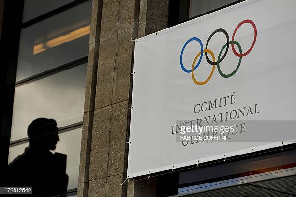 A statue is seen behind International Olympic Committee logo after an IOC Session on July 4 2013 in Lausanne Six candidates are in the running to...