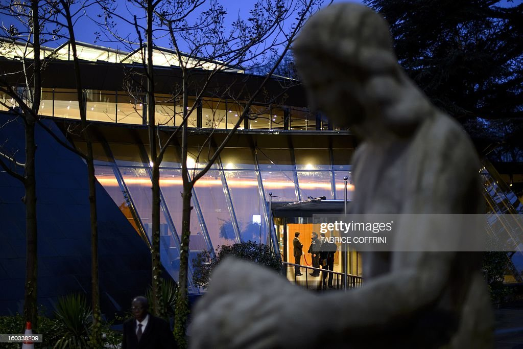 A statue is seen next to a building of the World Trade Organization (WTO) headquarters on January 29, 2013 in Geneva. WTO begins interviewing nine candidates to replace Pascal Lamy as director general. The WTO's 158 member countries is to make its decision known by May 31.