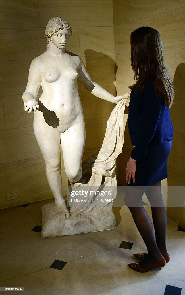 A statue 'La Grande Venus Victrix' which belonged to French artist Pierre-August Renoir and was executed by Renoir and Richard Guino, is on display at Heritage Auctions in New York, September 18, 2013. The single-largest archive of Renoir's personally-owned object, sculptures and letters are set to go on auction on September 19, 2013. AFP PHOTO/Emmanuel Dunand