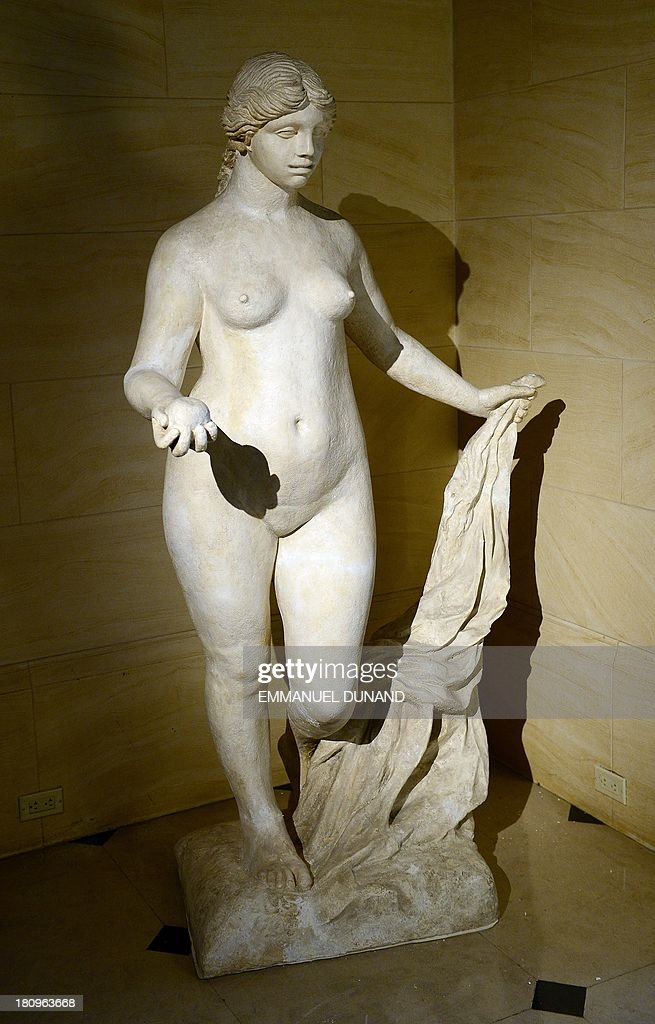A statue 'La Grande Venus Victrix' which belonged to late French artist Pierre-August Renoir and was executed by Renoir and Richard Guino, is on display at Heritage Auctions in New York, September 18, 2013. The single-largest archive of Renoir's personally-owned object, sculptures and letters are set to go on auction on September 19, 2013. AFP PHOTO/Emmanuel Dunand