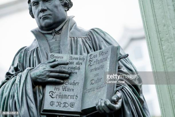 A statue of 16thcentury theologian Martin Luther holds a bible in the hand on the marketplace during the celebrations to commemorate the 500th...
