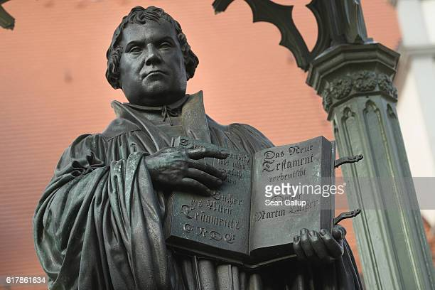 A statue of 16thcentury theologian Martin Luther stands on Marktplatz square on October 20 2016 in Wittenberg Germany In 1517 Luther nailed his 95...