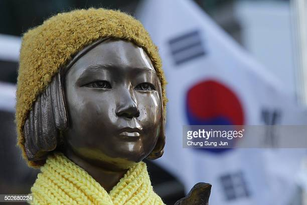 A statue of a girl symbolizing the issue of 'comfort women' in front of the Japanese Embassy on December 28 2015 in Seoul South Korea South Korean...