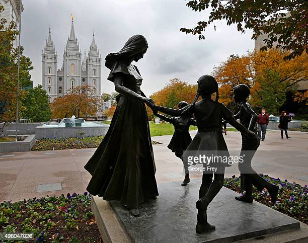 A statue of a mother and her children sit on display on the main campus of the World Headquarters of the Church of Jesus Christ of LatterDay Saints...