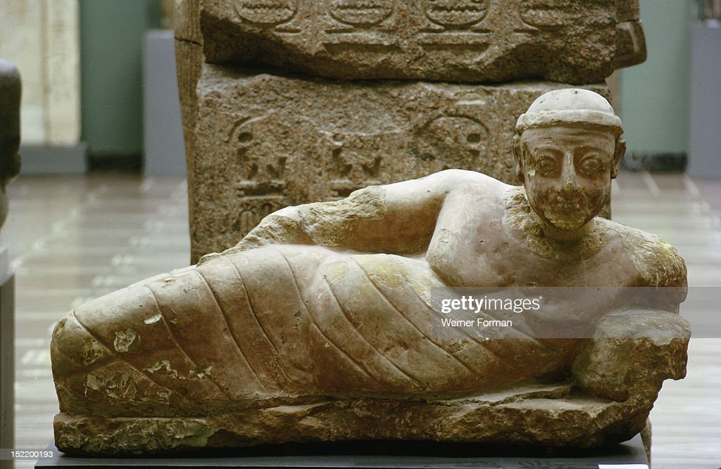 Statue of a reclining man found in a bath house at Meroe, Hellenistic influences diffused by trading contacts with Graeco Roman Egypt are apparent in the modelling of the figure. Sudan. Nubian. c 100 AD. Meroe.