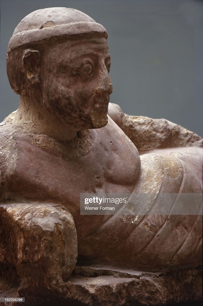 Statue of a reclining man found in a bath house at Meroe, Hellenistic influences diffused by trading contacts with Graeco Roman Egypt are apparent in the modelling of the figure.Detail. Sudan. Nubian. c 100 AD. Meroe.