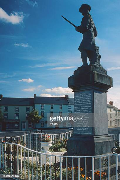 A statue of a soldier erected to commemorate those who took part in the 1921 War Of Independence in the village square of Galbally County Limerick...