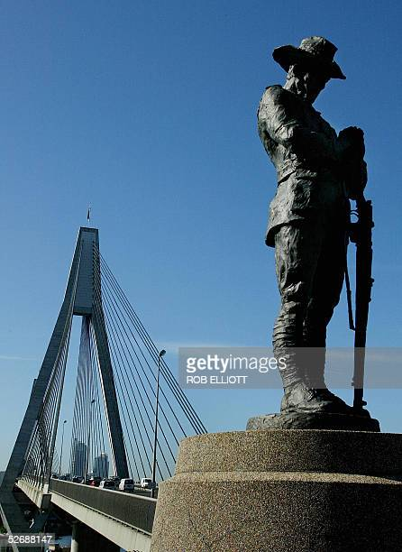 A statue of a soldier representing Australia and New Zealand Army Corps stands on a memorial at the end of the ANZAC Bridge in Sydney 22 April 2005...