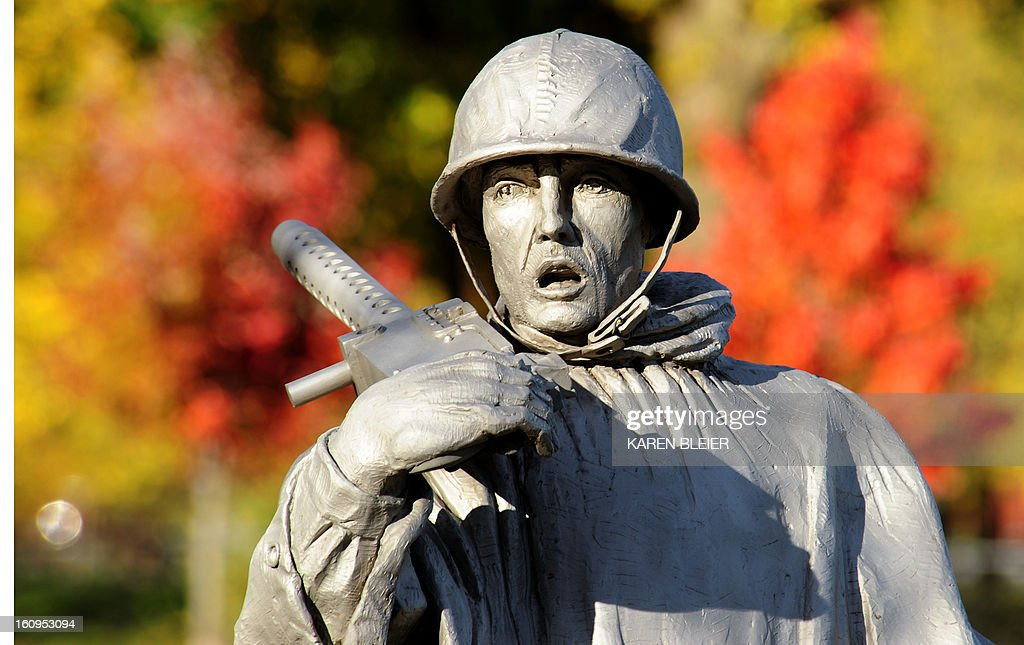 A statue of a US soldier is seen at the Korean War Memorial on November 15 2009 on a sunny day in Washington Temperatures soared into the mid 70's...