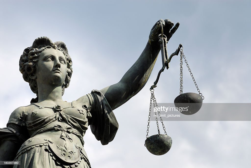 Statue of a woman holding a balance scale : Stock Photo