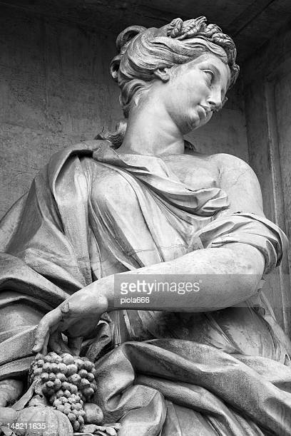 Statue of a Woman with Grapes at Trevi Fountain