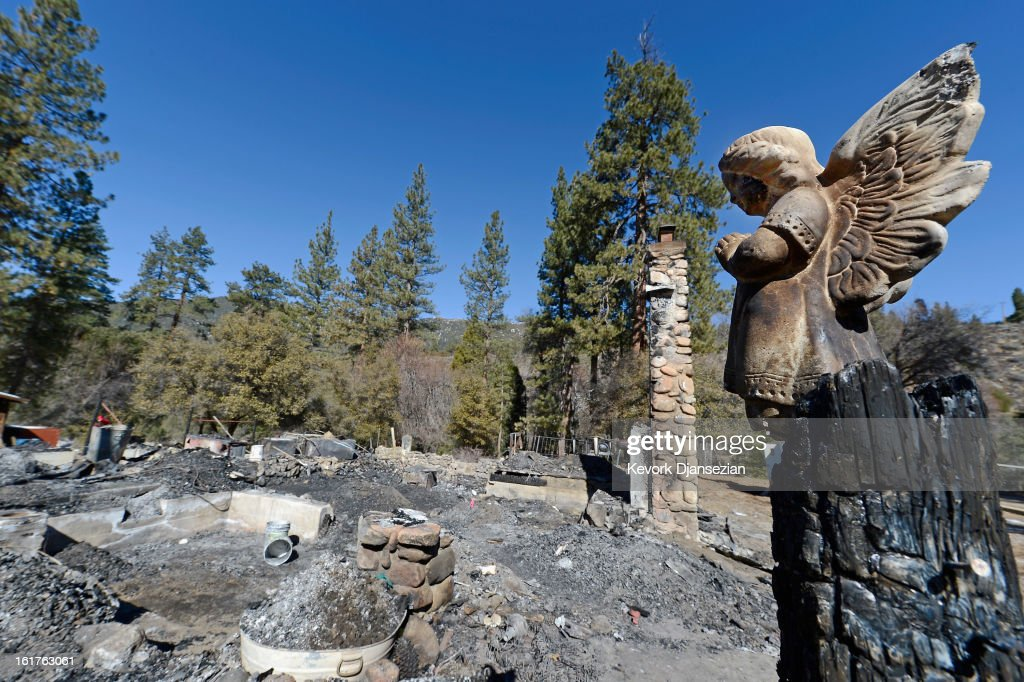 A statue of an angel stands on a wood column in front of the burned out cabin where remains of murder suspect former Los Angeles Police Department officer Christopher Dorner were found on February 15, 2013 in Big Bear, California. Dorner, a former Los Angeles Police Department officer and Navy Reserve veteran, barricaded himself in the cabin near Big Bear, California, and engaged law enforcement officers in shootout, shooting two police, killing one and wounding the other. Dorner's, who's body was identified after being found, was wanted in connection with the deaths of an Irvine couple and a Riverside police officer.