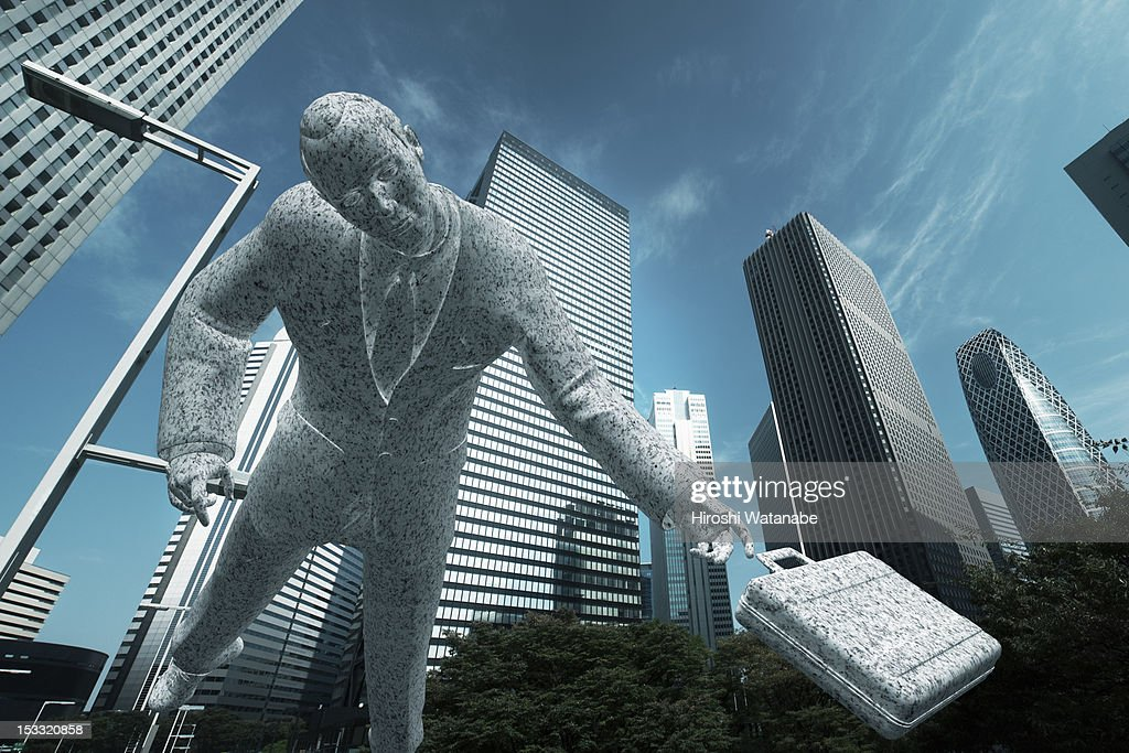Statue of an overworked businessman : Stock Photo