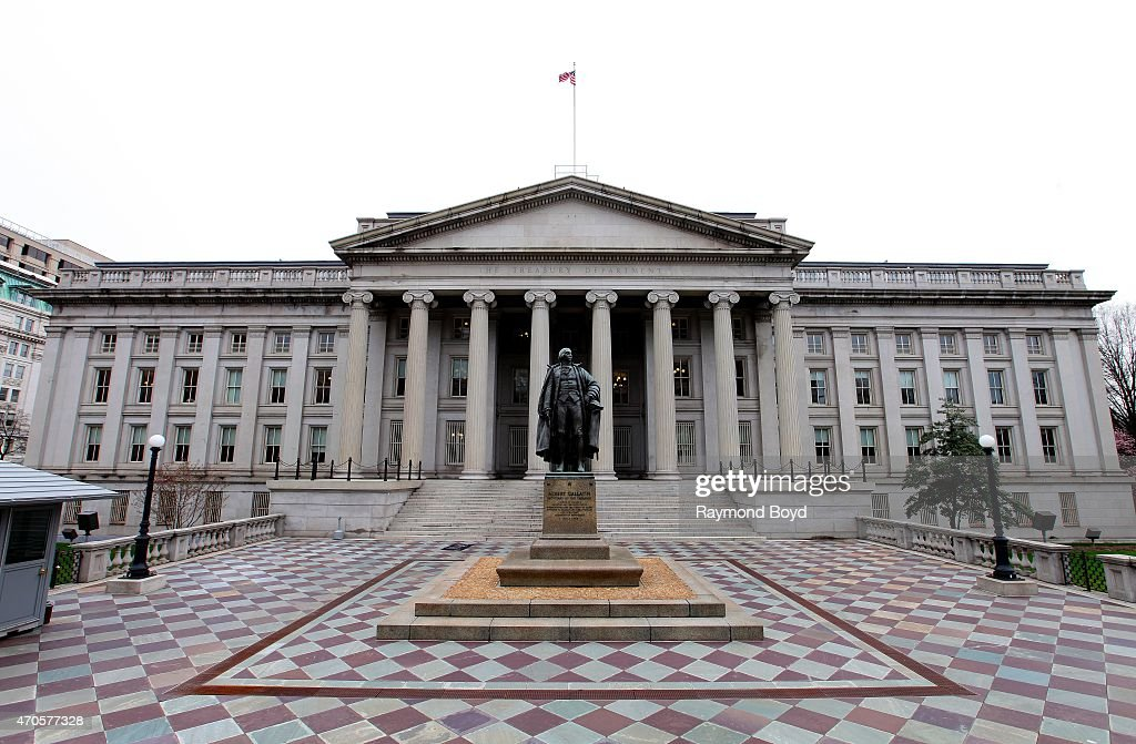 A statue of Andrew Gallatin sits outside the US Department of the Treasury on April 10 2015 in Washington DC