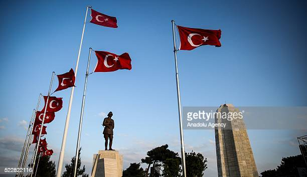 Statue of Ataturk waving Turkish flags and New Zealand National Memorial are seen on Gallipoli Peninsula in Canakkale Turkey on April 20 2016...