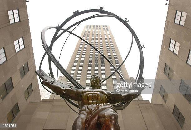 A statue of Atlas stands between buildings at Rockefeller Center December 22 2000 in New York Rockefeller Center has been sold for $18 billion...