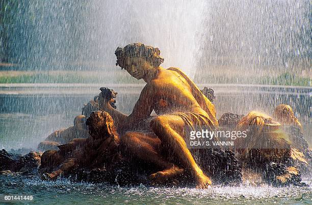 Statue of Bacchus in the Bacchus fountain fountain in the gardens of the Palace of Versailles IledeFrance France 17th century