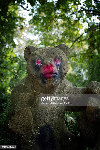 Statue Of Bear With Painted Red Eyes And Nose