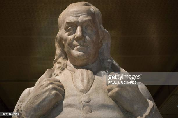 A statue of Benjamin Franklin printer journalist diplomat tatesman philosopher and the father of the US Postal System is seen at the US National...