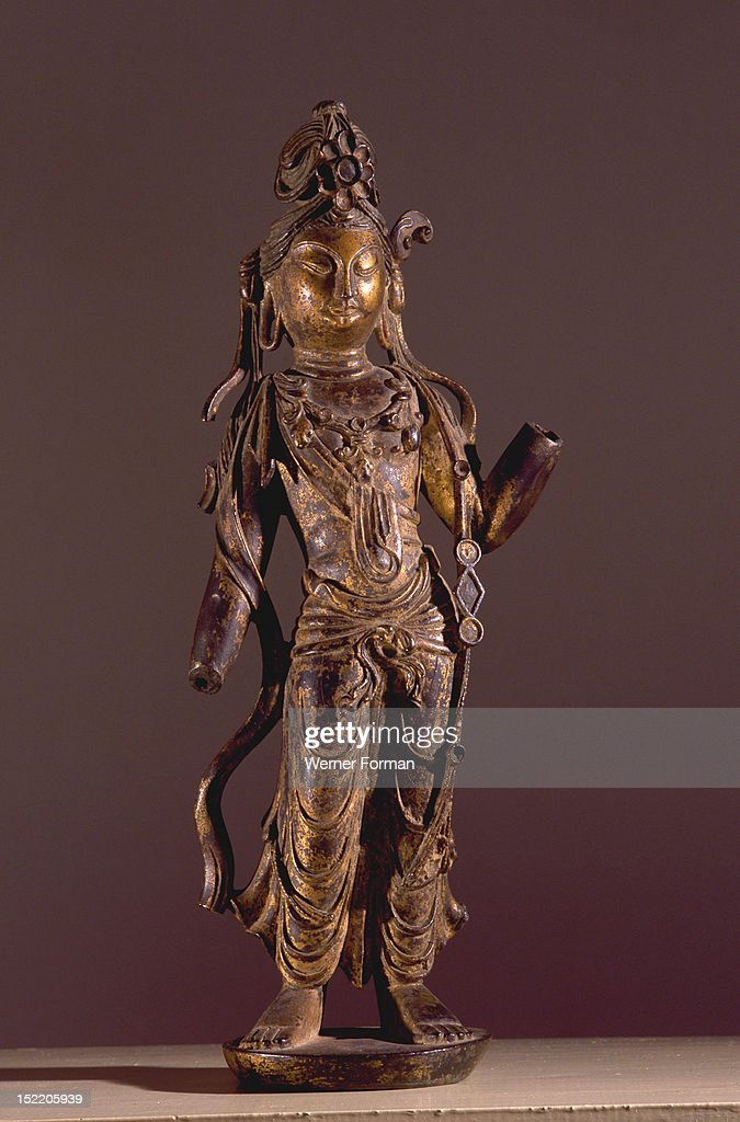 Statue of Bodhisattva Guanyin Goddess of Mercy decorated with chased ornaments China Chinese Perida/ Date Tang Dynasty 8th century AD