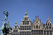 Statue of Brabo Fountain in Grote Markt (Town Square) with guilds houses in background.