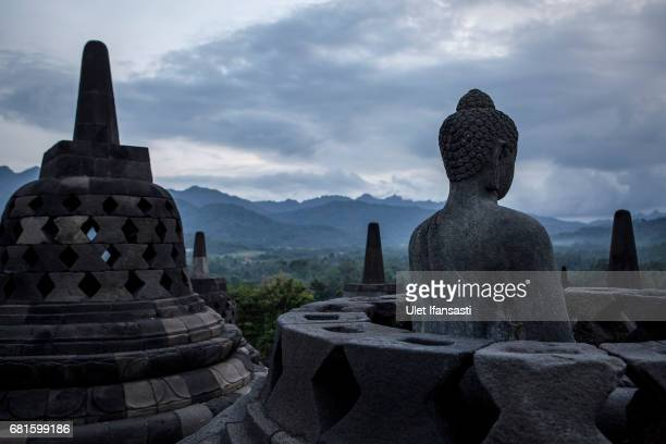 A statue of Buddha at Borobudur temple during celebrations for Vesak Day on May 10 2017 in Magelang Central Java Indonesia Buddhists in Indonesia...