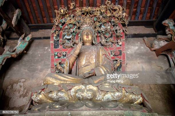 Statue of Buddha from Ming Dynasty The Shuanglin Temple is famous for more than 2000 colorful well preserved sculptures left from the Song Yuan Ming...